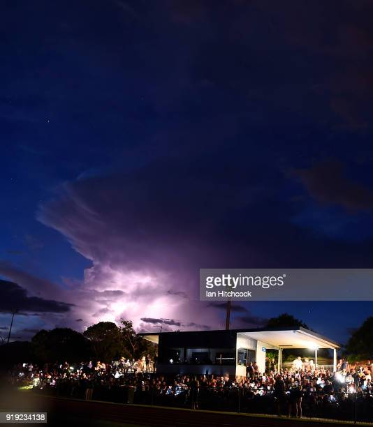 Lightning flashes are seen during a power outage before the start of the NRL trial match between the North Queensland Cowboys and the Wests Tigers at...