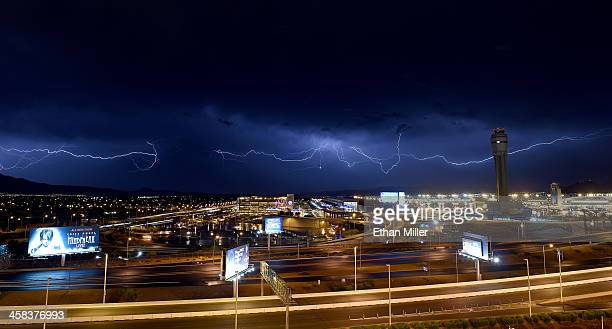 Lightning flashes east of McCarran International Airport on July 2 2016 in Las Vegas Nevada Two days of monsoon thunderstorms brought strong winds...