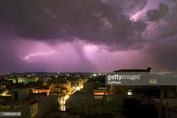 Lightning flashes illuminates the sky over the walled city during the thunderstorm in Jaipur, Rajasthan, India, on May 22, 2021.