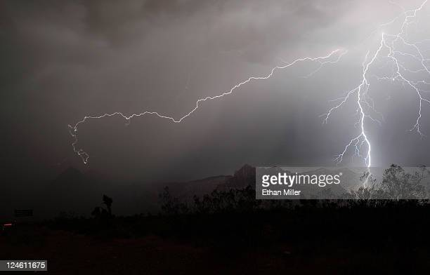 Lightning flashes in the Red Rock Canyon National Conservation Area during a thunderstorm early on September 11 2011 in Las Vegas Nevada More storms...