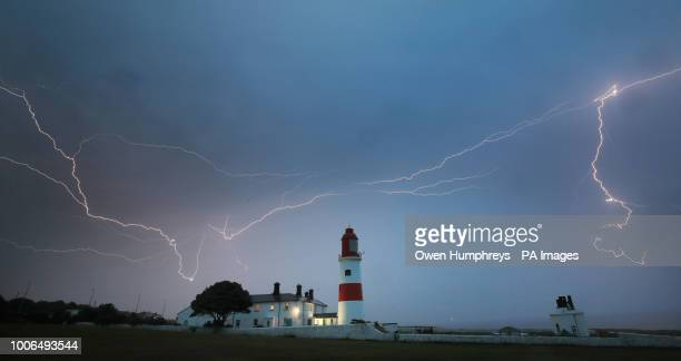 Lightning flashes over Souter lighthouse in South Shields as heavy thunderstorms marked the end of the UK heatwave on Friday