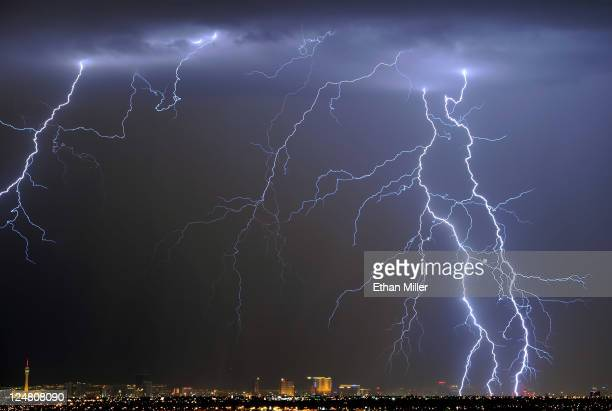 Lightning flashes over the Las Vegas Strip during a thunderstorm early on September 13 2011 in Las Vegas Nevada Stormy weather is expected to...