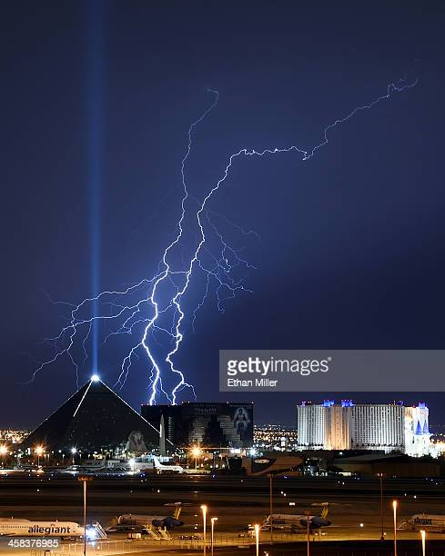 Lightning flashes west of the Luxor Hotel and Casino and the Excalibur Hotel Casino on July 2 2016 in Las Vegas Nevada Two days of monsoon...