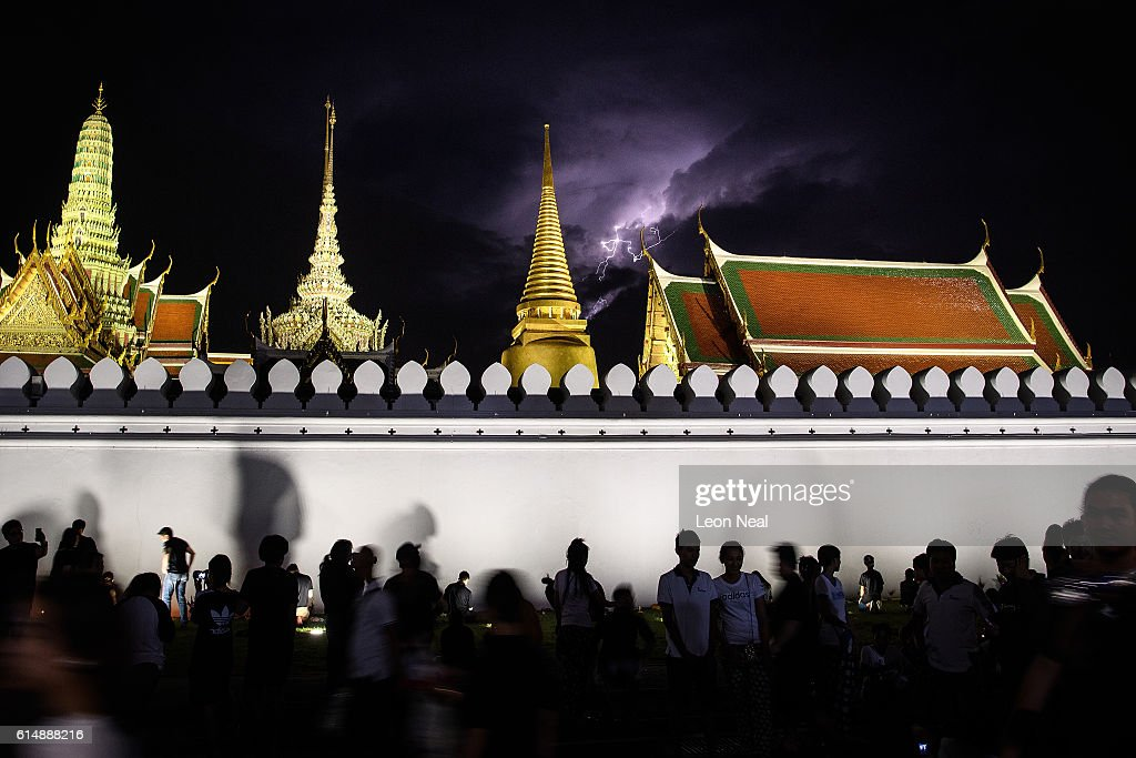Lightning illuminates the night sky above the Grand Palace in the early hours of October 16, 2016 in Bangkok, Thailand. Thailand's King Bhumibol Adulyadej, the world's longest-reigning monarch, died at the age of 88 in Bangkok's Siriraj Hospital on Thursday after his 70-year reign. The Crown Prince Maha Vajiralongkorn had asked for time to grieve the loss of his father before becoming the next king as the nation waits for the coronation date.