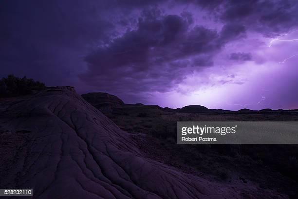 Lightning illuminates the skies as a storm front moves over Dinosaur Provincial Park; Alberta, Canada
