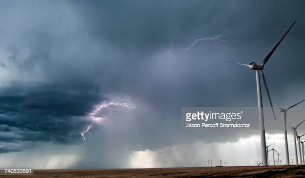 Lightning in clouds by wind farm in rural area, Limon, Colorado, United States, North America