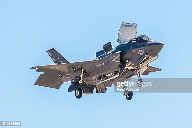 F-35 Lightning in slow or V.T.O.L configuration with jet exhaust flow diverters extended.