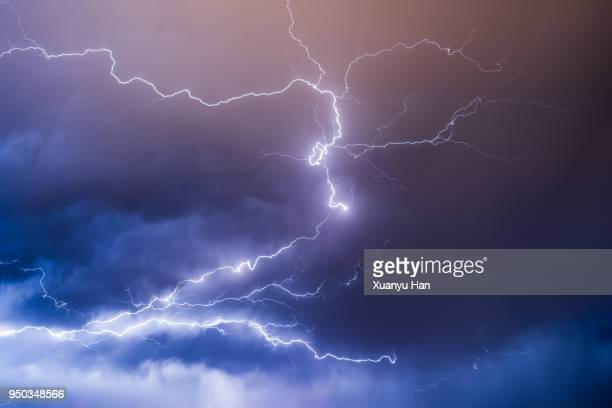 lightning in the night sky during a thunderstorm - weather stock pictures, royalty-free photos & images