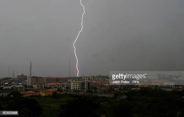 A lightning is seen over the nigerian city of Abuja during a tempest on October 22 2009 in Abuja Nigeria