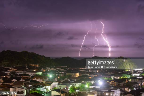 lightning on pacific ocean and residential district in kanagawa prefecture of japan - kanagawa prefecture stock pictures, royalty-free photos & images