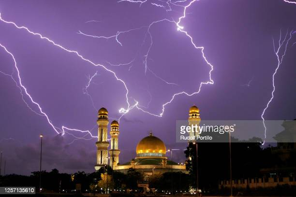 lightning over a majestic mosque - brunei stock pictures, royalty-free photos & images