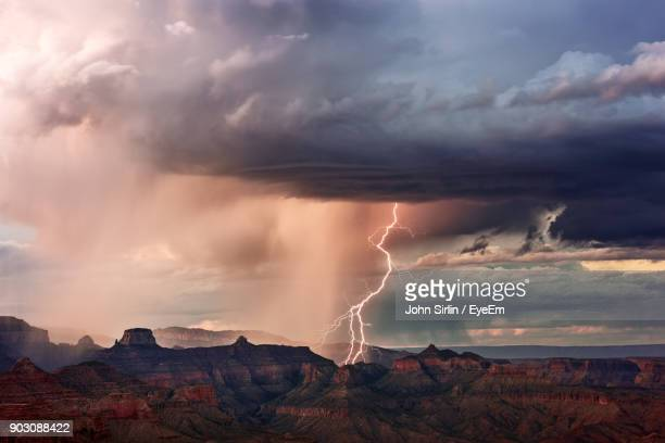 Lightning Over Mountains During Sunset