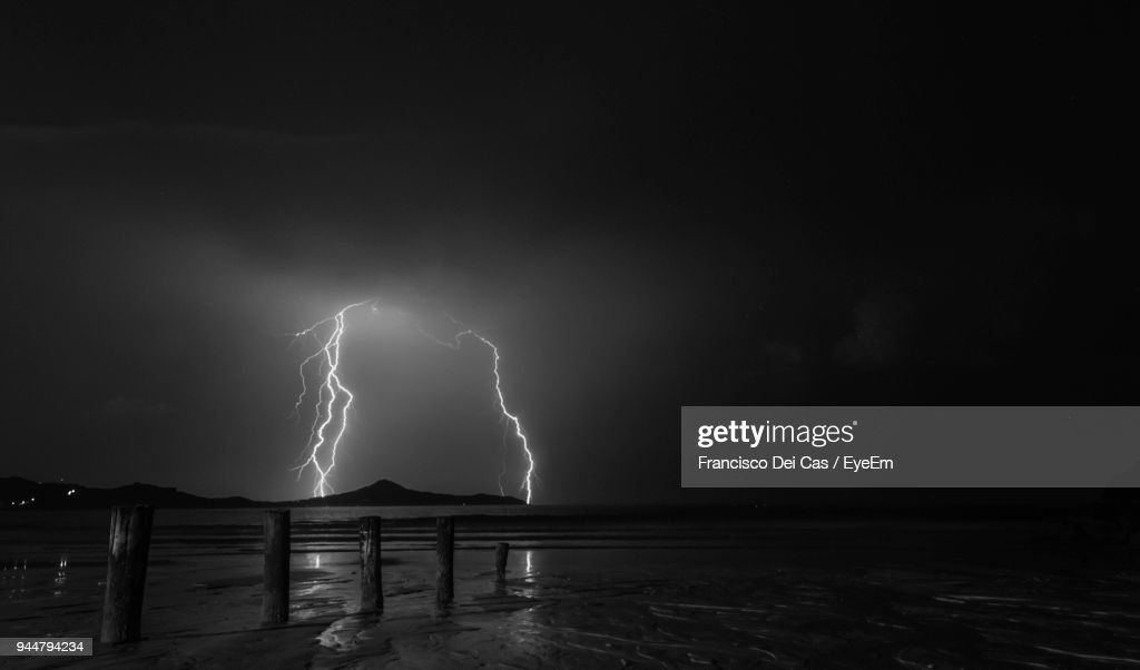 Lightning Over Sea Against Sky At Night : Stock Photo