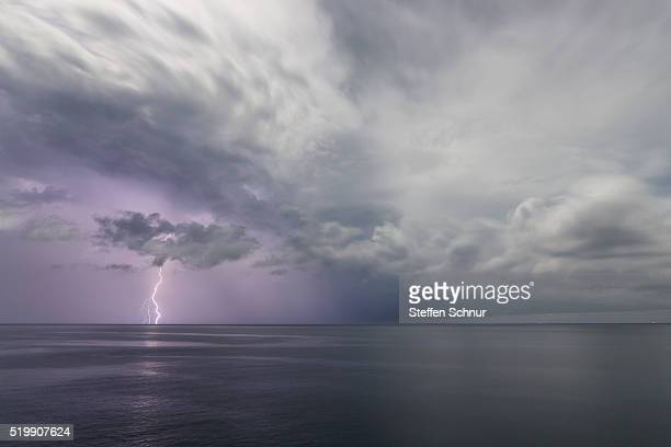 lightning over sea naturale phenomenon - light natural phenomenon stock photos and pictures