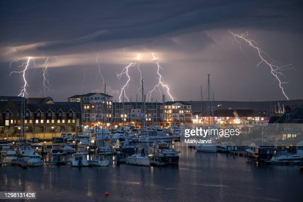 lightning over sovereign harbour eastbourne - lightning stock pictures, royalty-free photos & images