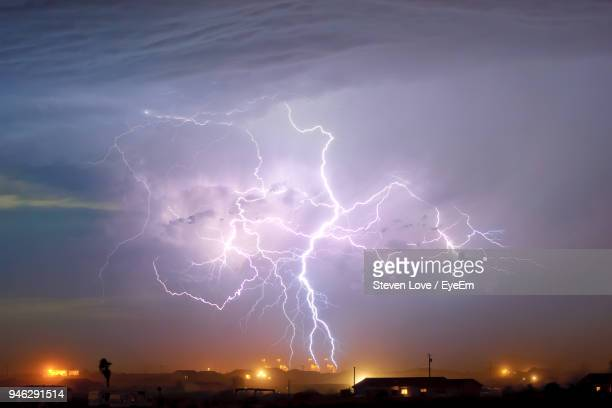 Lightning Over Town At Night