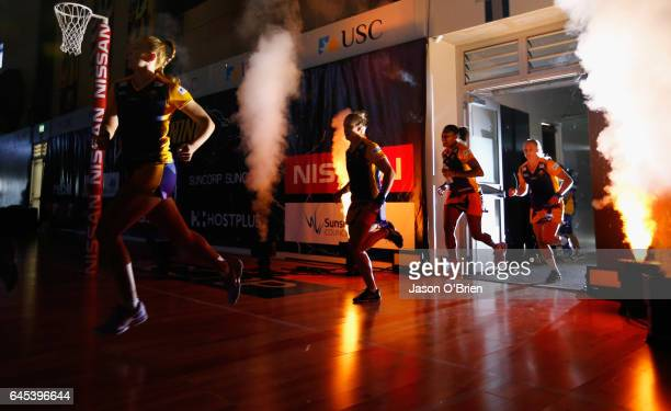 Lightning players take the court to warm up during the round two Super Netball match between the Queensland Firebirds and the Melbourne Vixens at...