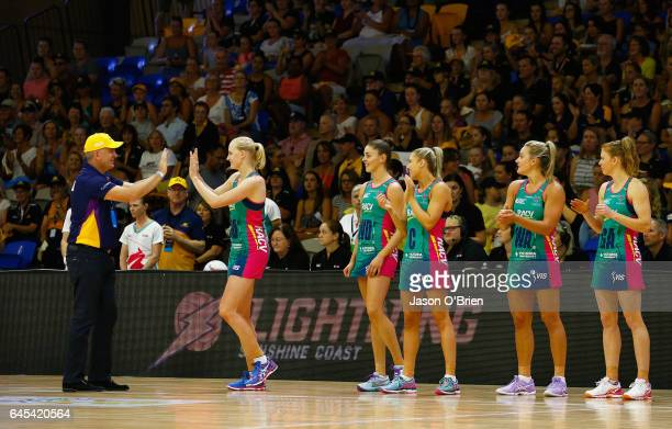 Lightning players take to the court during the round two Super Netball match between the Queensland Firebirds and the Melbourne Vixens at University...