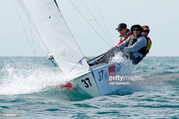 Lightning skippered by Cristobal Perez of Chile sails upwind during the practice race a day prior to the start of the 2011 Lightning World...