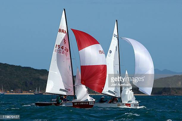 Lightning skippered by Fred Bojlensen of Brazil and Lightning skippered by Tom Allen Jr. Of the USA sail downwind during the practice race a day...