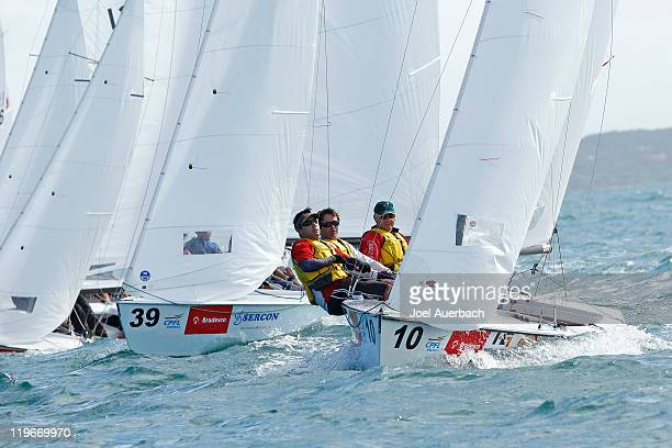 Lightning skippered by Ian Edwards of Australia leads the fleet over the starting line for the practice race a day prior to the start of the 2011...