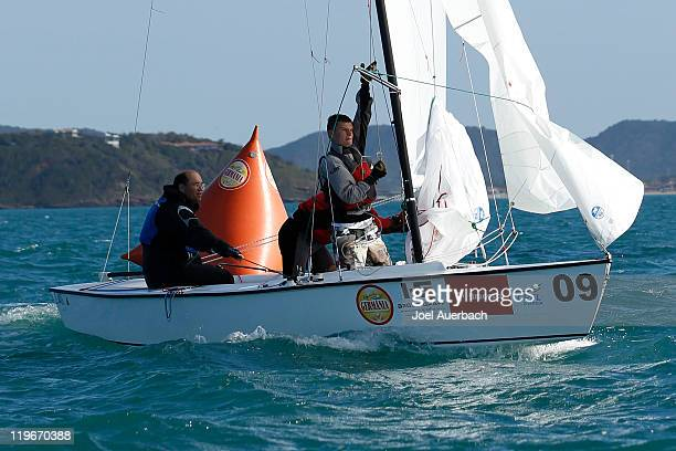 Lightning skippered by Tom Allen Jr. Of USA steers as the spinnaker is set during the practice race a day prior to the start of the 2011 Lightning...