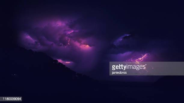 lightning storm at night. - seascape stock pictures, royalty-free photos & images