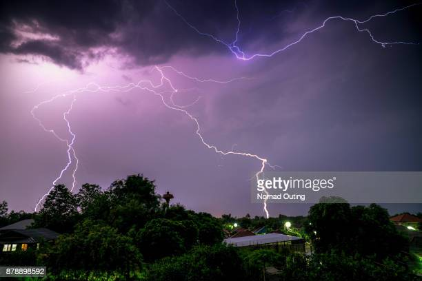 lightning storm in bad weather,danger electric from sky,lightning storm glow in the dark,nature weather disaster,stack images
