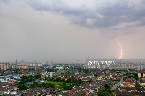 lightning storm over downtown kuala lumpur skyline during monsoon season. - shaifulzamri stock pictures, royalty-free photos & images
