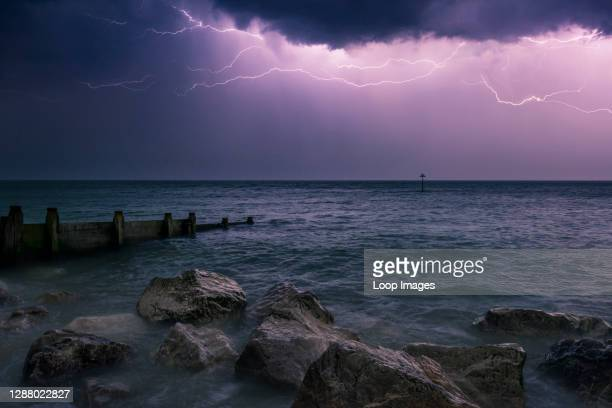 Lightning storm over the English Channel at night viewed from the West Sussex coast.