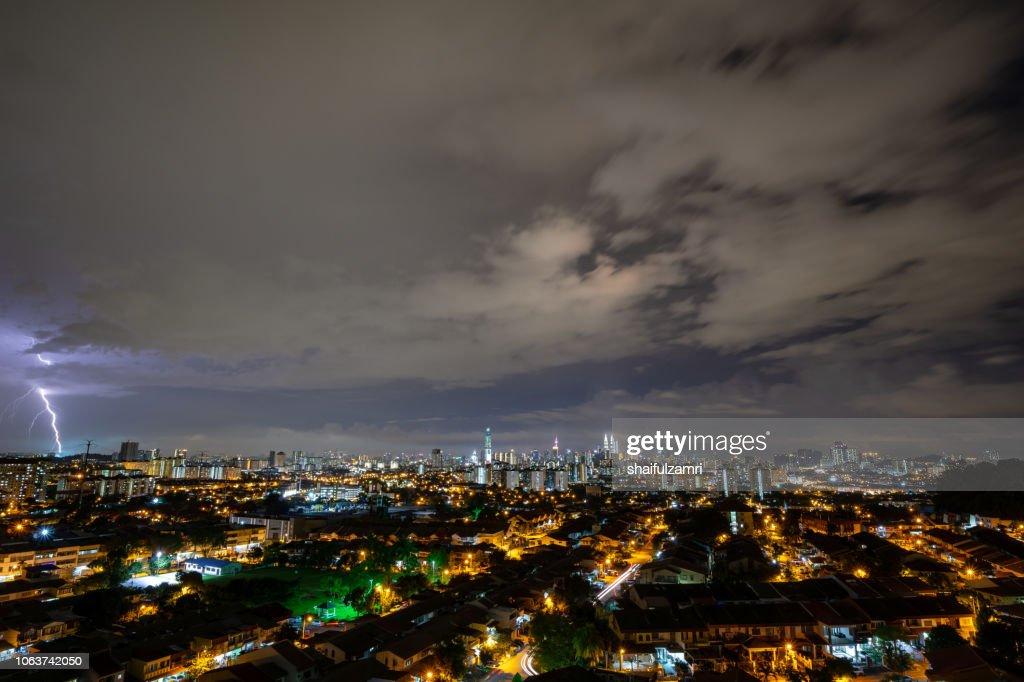Lightning strike during thunderstorm over downtown Kuala Lumpur, Malaysia. : Stock Photo