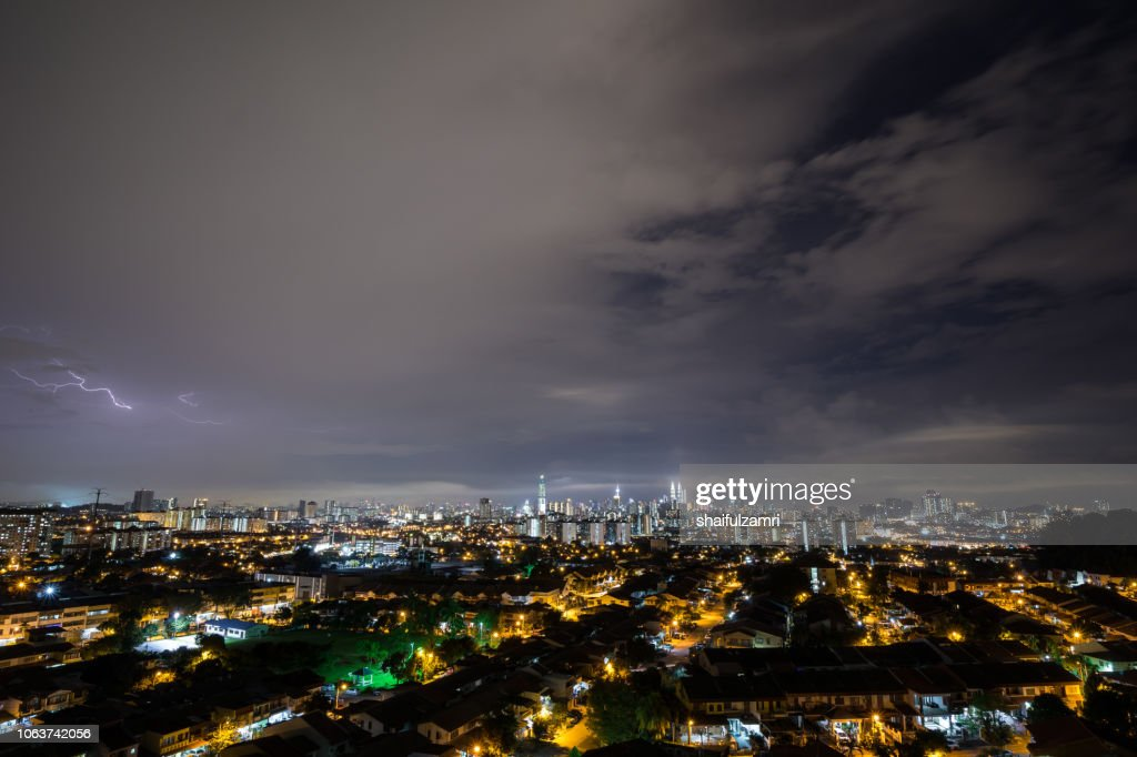 Lightning strike during thunderstorm over downtown Kuala Lumpur, Malaysia. : Stock Photo