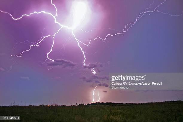 Lightning strike in rural landscape