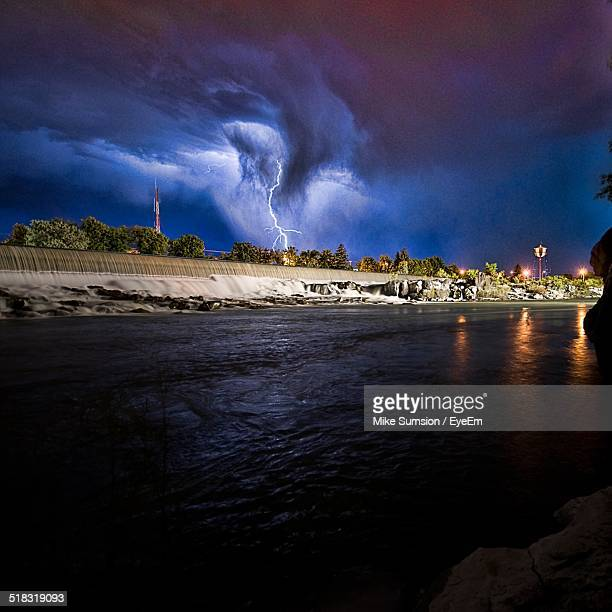 lightning strike in rural landscape with lake in foreground - idaho falls stock photos and pictures