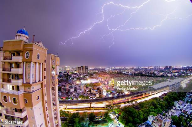 lightning strike over a modern indian city at night - chennai stock pictures, royalty-free photos & images