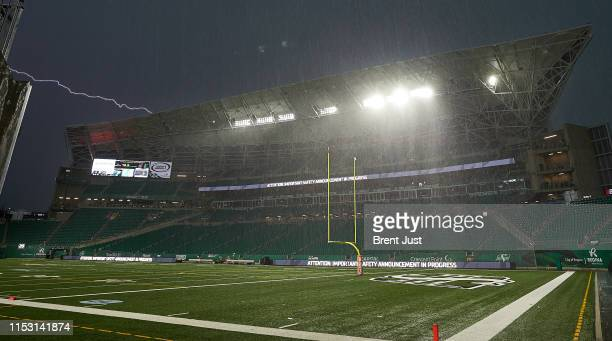 Lightning strike over Mosaic Stadium during a passing storm which caused a delay with 1:34 remaining in the first half of the game between the...