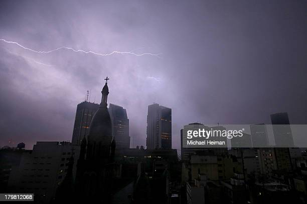 Lightning strikes a building on the Buenos Aires skyline ahead of the 125th IOC Session 2020 Olympics Host City Announcement at Hilton Hotel on...
