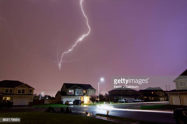 lightning strikes above home - storm stock pictures, royalty-free photos & images