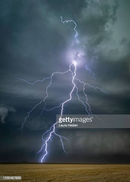 lightning strikes and severe weather on the great plains - overcast stock pictures, royalty-free photos & images