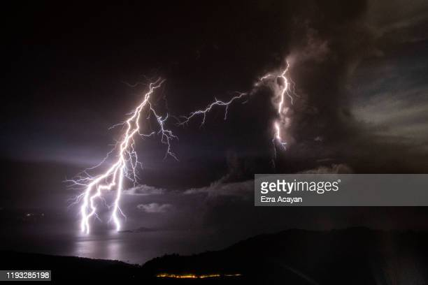 Lightning strikes as a column of ash surrounds the crater of Taal Volcano as it erupts on January 12 2020 as seen from Tagaytay city Cavite province...
