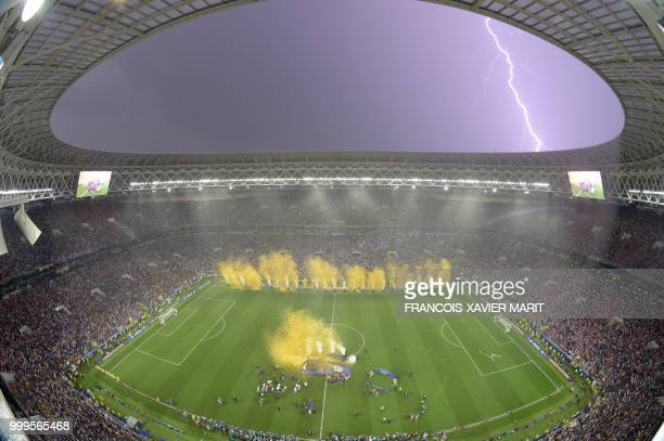 TOPSHOT Lightning strikes as France players celebrate after the Russia 2018 World Cup final football match between France and Croatia at the Luzhniki...