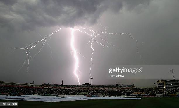 Lightning strikes as the players leave the field due to an electrical storm during the NatWest Series One Day International between England and...