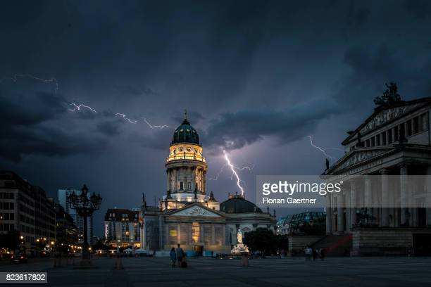 Lightning strikes behind the German Chruch and the Konzerthaus at the Gendarmenmarkt on July 27 2017 in Berlin Germany