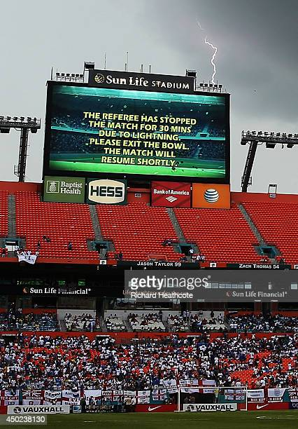 Lightning strikes behind the scoreboard as the match is delayed due to inclement weather during the International Friendly match between England and...