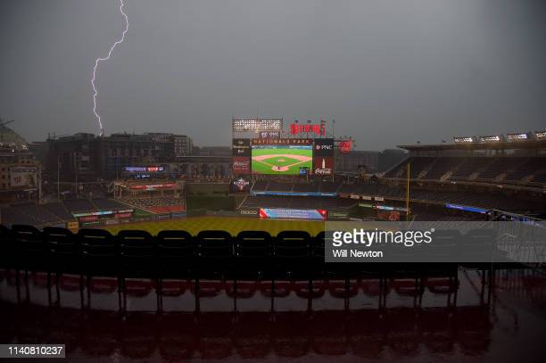 Lightning strikes during a rain delay prior to the start of the game between the Washington Nationals and the St Louis Cardinals at Nationals Park on...