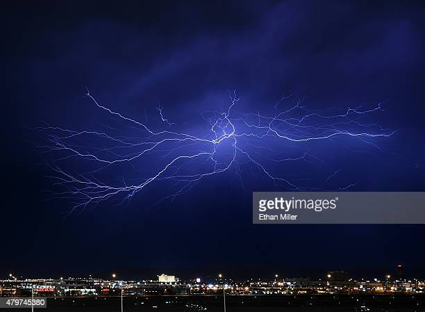Lightning strikes during a thunderstorm on July 7 2015 in Las Vegas Nevada The monsoon storm dropped heavy rain and hail in parts of the valley...
