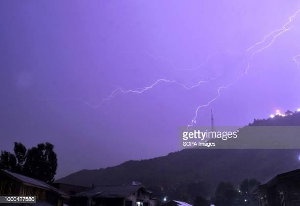 Lightning strikes early Tuesday morning over the Zabarwan hills in Srinagar Indian administered Kashmir
