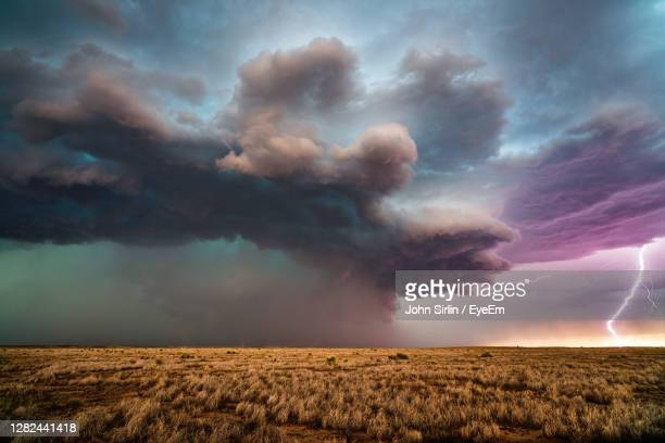 lightning strikes from a supercell thunderstorm near roswell, new mexico. - lightning stock pictures, royalty-free photos & images