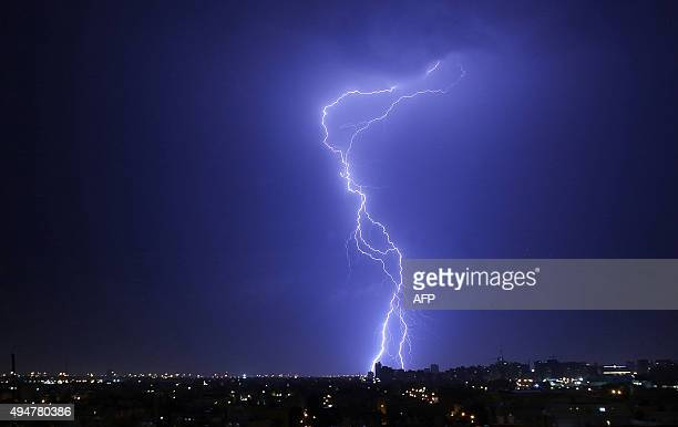 Lightning strikes in the sky over Kuwait City before a rainstorm hits the country early on October 29 2015 AFP PHOTO / YASSER ALZAYYAT / AFP / YASSER...