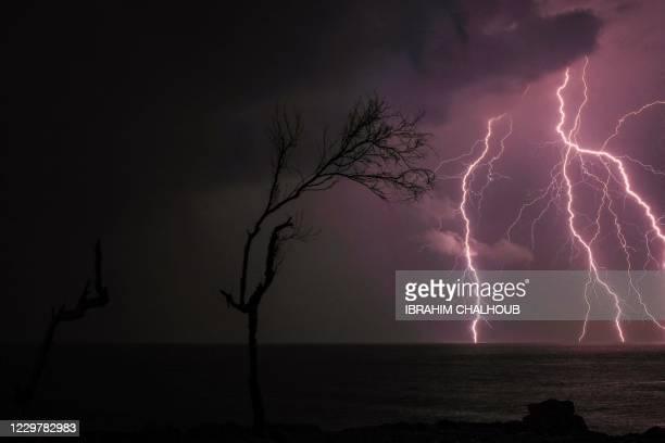 Lightning strikes off the coast of the mediterranean city of Batroun in northern Lebanon, on November 25, 2020.